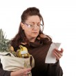 Grocery Shopper Counting Costs — Stock Photo