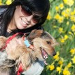 Foto Stock: Woman and Her Dog in the Spring Time
