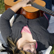 Girl Playing a Guitar — Stock Photo #8944408