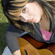 Girl Playing a Guitar — Stock Photo #8944417