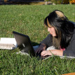 Girl Using a Laptop — Stock Photo #8944427