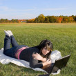 Girl Using A Laptop — Stock Photo #8944445