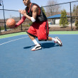 Stock Photo: Basketball Player Dribbling