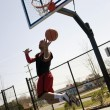 Stock Photo: Basketball Player Layup