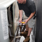 HVAC Technician Working — Stock Photo #8944752