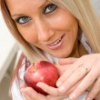 Woman and Apple - Stock Photo