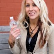Girl with Bottled Water — Stock Photo