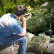 Thinking by the Waterfall — Stock Photo