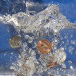 geld in water — Stockfoto