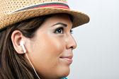 Woman Wearing Earbud Headphones — Stock Photo