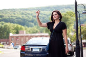 Woman Hailing a Taxi Cab — Stock Photo