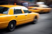 Speeding Yellow Taxi Cabs Motion Blur — Stock Photo