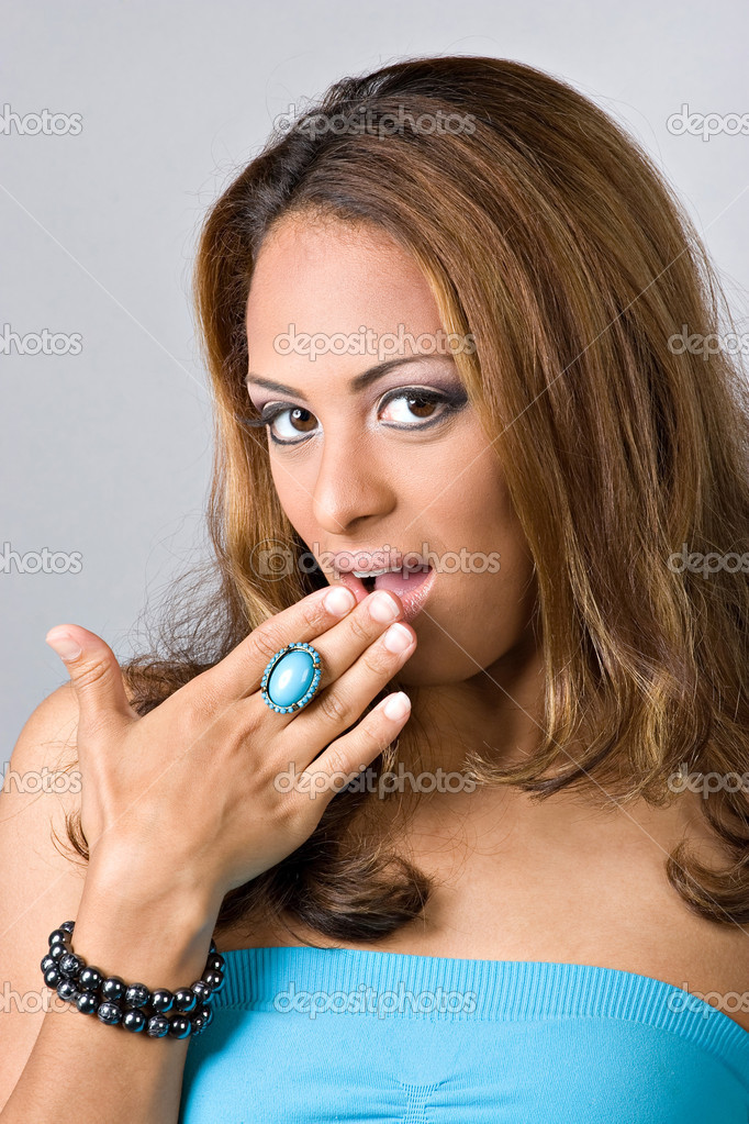 A flirty Spanish woman covering her mouth out of surprise. — Stock Photo #8944233
