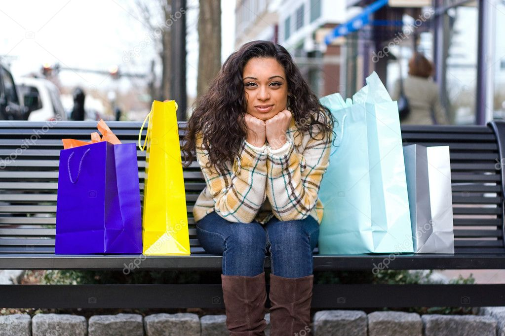 An attractive girl out shopping in the city.  Stock Photo #8944996