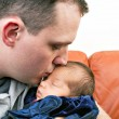 Happy Father Kisses His Newborn Baby — Stock Photo