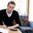 Male College Student Doing His Homework — Stock Photo