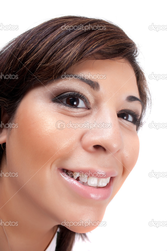 Woman with a happy look on her face smiles over a white background. Shallow depth of field. — Zdjęcie stockowe #9226416