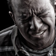 Man In Extreme Anguish or Pain - Stock Photo