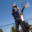 Stock Photo: Man Playing Basketball