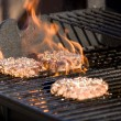 Flaming Hamburgers - Stock Photo