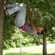 Stock Photo: WomHanging from Tree