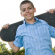 Stock Photo: Teenager with His Skateboard