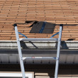 Stock Photo: Blown Out Roof Shingles Repair