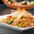 Seafood Pad Thai with Stir Fried Rice Noodles - Stock Photo