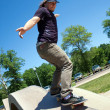 Skateboarder Rail Grinding at a Concrete Skate Park — Stock Photo #9240785