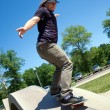 Skateboarder Rail Grinding at a Concrete Skate Park — Stock Photo