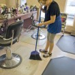 Stock Photo: Hairdresser Sweeping