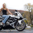 Blonde Woman On a Motorcycle — Stock Photo