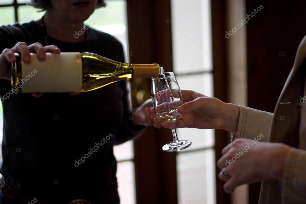 Closeup of some wine glasses being poured during a wine tasting. — Stock Photo #9240136