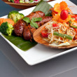 Thai Sausage with Som Tum Salad — Stock Photo #9377108