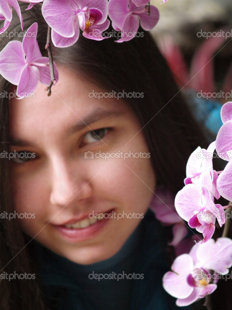Pretty young girl among the orchids  Stock Photo #10150332