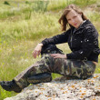 Girl sits on the stone somewhere in Crimean spaces - Stock Photo