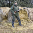 Young man hunting in the field — Stock Photo #8115024