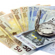 Euro banknotes and antique clock — Stock Photo #8412184