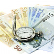 Euro banknotes and antique clock — Stock Photo #8412188