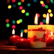 Beautiful candles on wooden table on bright background - Zdjęcie stockowe