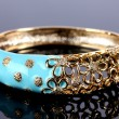 Beautiful golden bracelet on grey background — ストック写真