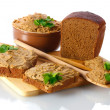 Fresh pate with bread on wooden board isolated on white - Stock Photo