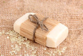 Hand-made herbal soap on sackcloth — Stock Photo