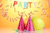 Party items on orange background — Stockfoto