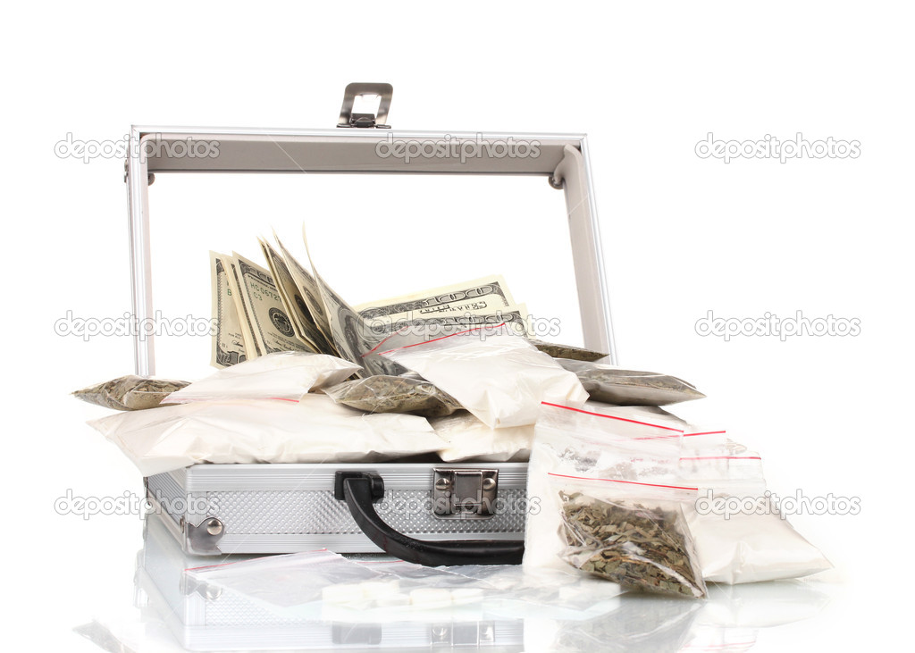 Cocaine and marijuana in a suitcase isolated on white — Stock Photo #10014793