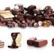 Collage of assorted delicious chocolate bars, biscuits and candy isolated on white — Stock Photo