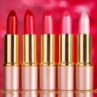 Beautiful lipsticks on red background - Foto de Stock