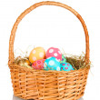 Colorful Easter eggs in the basket isolated on white — Stock Photo #10025976