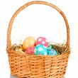 Colorful Easter eggs in the basket isolated on white — Stock Photo
