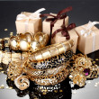 Beautiful golden jewelry and gifts on grey background - Lizenzfreies Foto